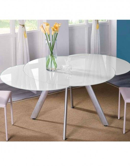 The Butterfly Expandable Round glass Dining Table extends its wings in  metamorphosis to become a full 8 seat dinner setting.