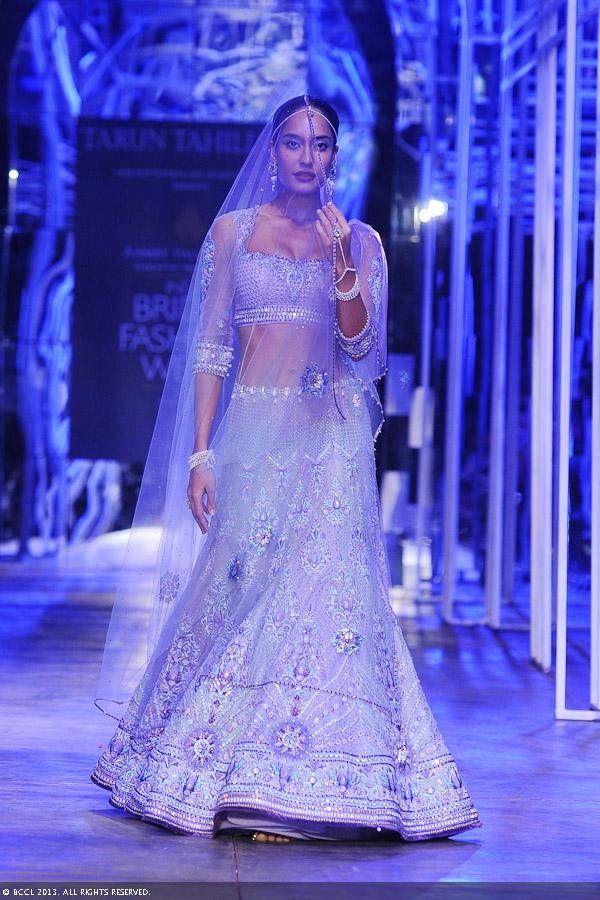 cream lehengha, Lisa Haydon walks the ramp for designer Tarun Tahiliani during the Grand Finale of the India Bridal Fashion Week (IBFW) 2013, held in New Delhi.