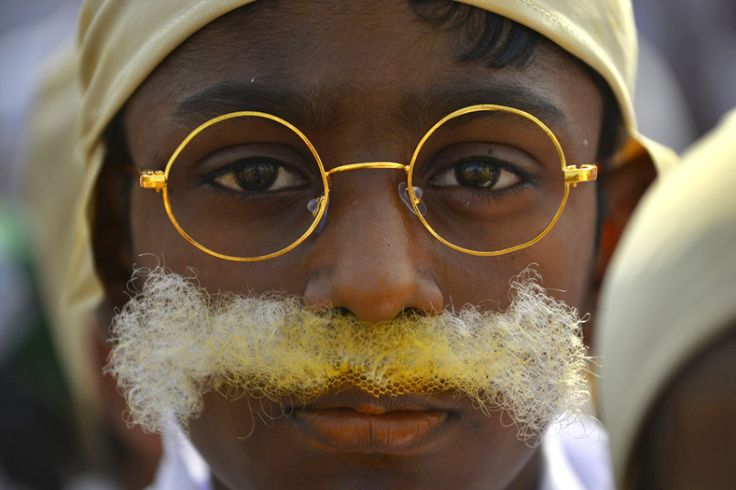 An Indian child dressed as Mahatma Gandhi takes part in an event to mark his birthday in New Delhi