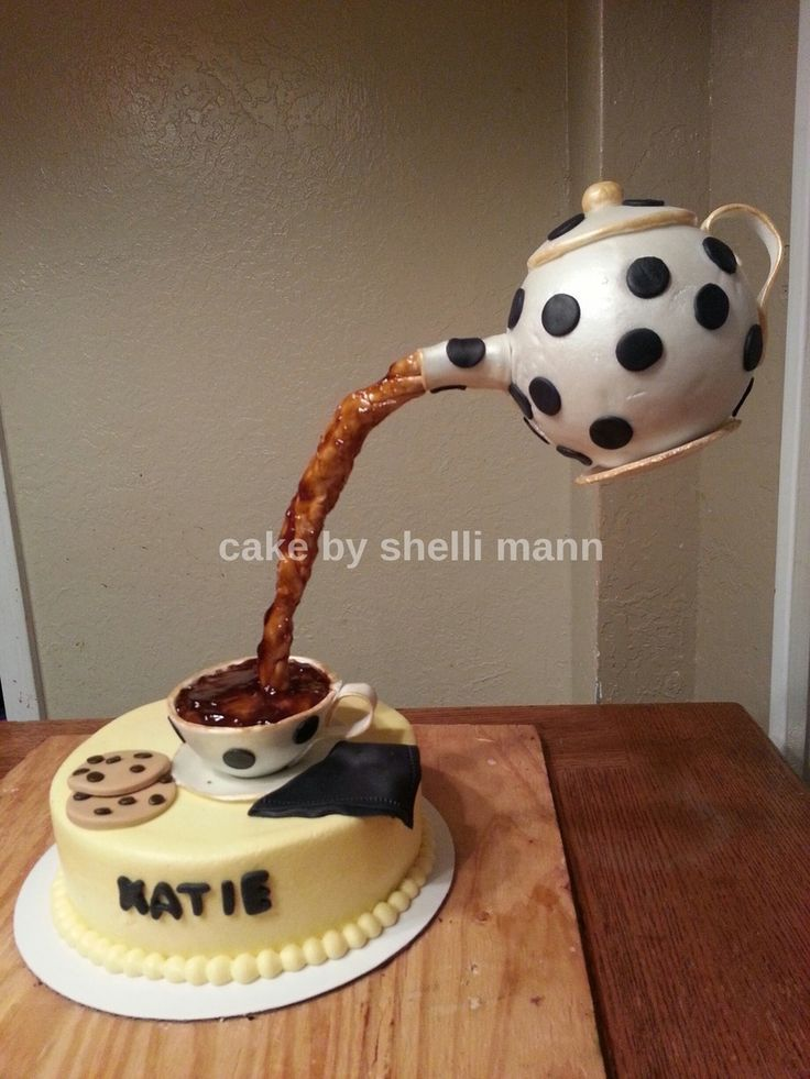 This is a buttercream cake with a gumpaste teacup and...
