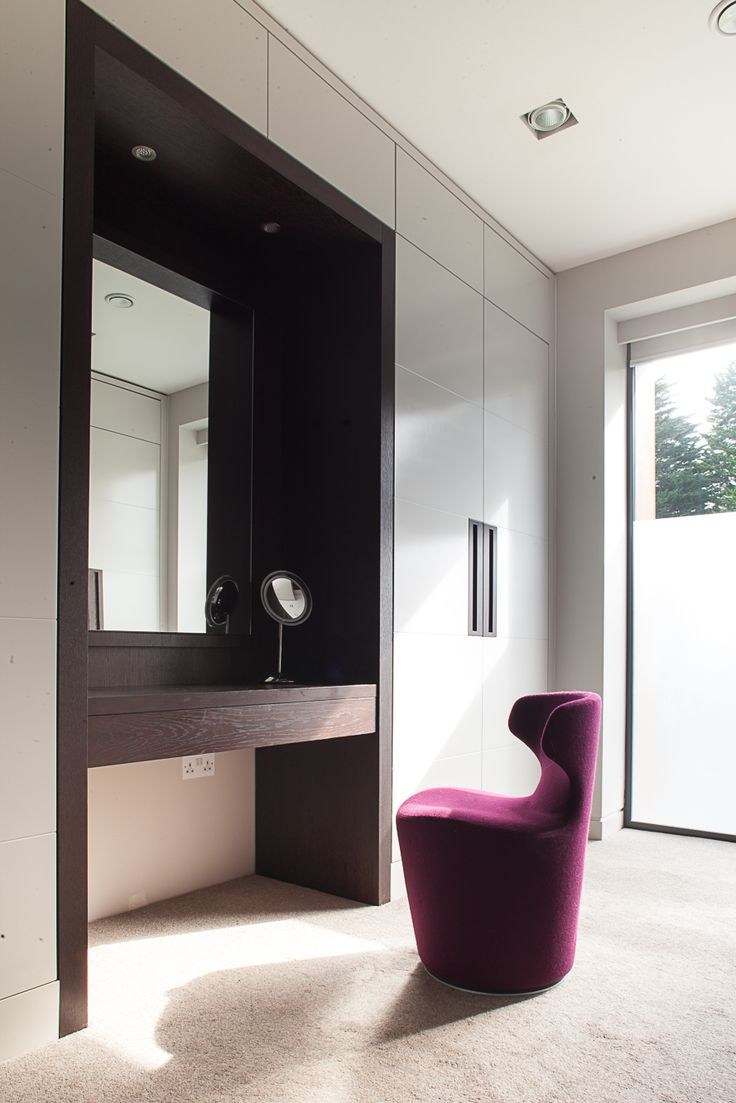 Contemporary dressing room. The handles are flush inset stained oak.