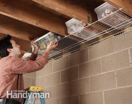 Joist cavities are the perfect size for plastic storage containers. Use one wire shelf to hold the containers.