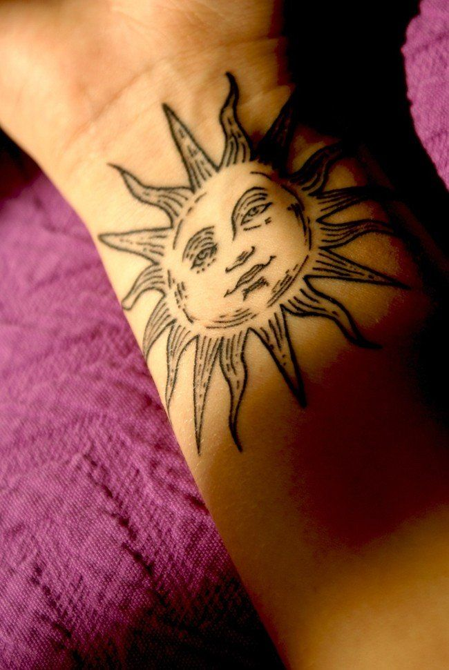 Sun tattoo on the arm More