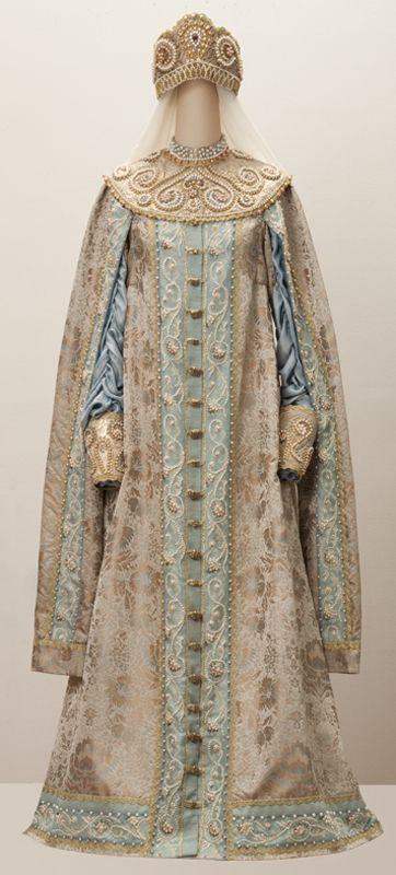 [contemporary repro]     Artist - Designer : SA Sidelnikova . Masters : G.P.Grischenko , SA Sidelnikova . outfit is : breeches ( silk) coat ( silk jacquard , taffeta ) Mantle , cuffs , headpiece ( brocade , ribbons , pearls )