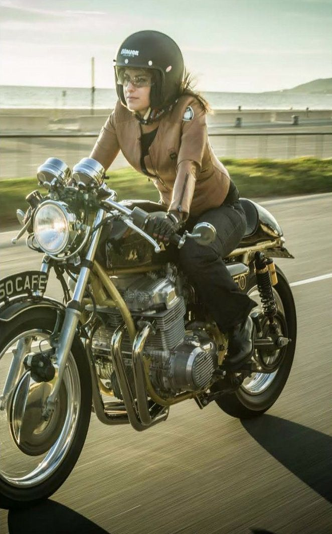 Pretty lady on a bike, a little on the hot side. No offense to the wife. Haha