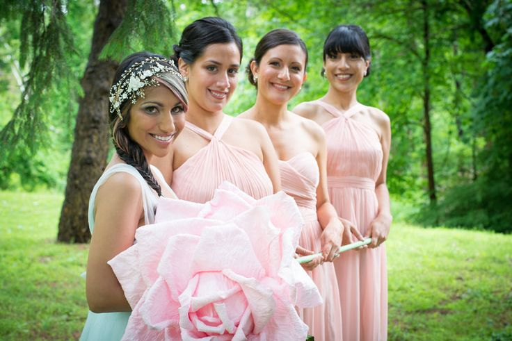 Bride with her bridesmaids photo with large flower prop Jenica+Josh Photo By Sherry Sutton Photography