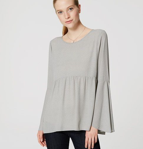 With bell sleeves and a peplum waist, this flowy blouse is a romance in and of itself. Round neck. Long bell sleeves. Back button keyhole. Shirred peplum waist.