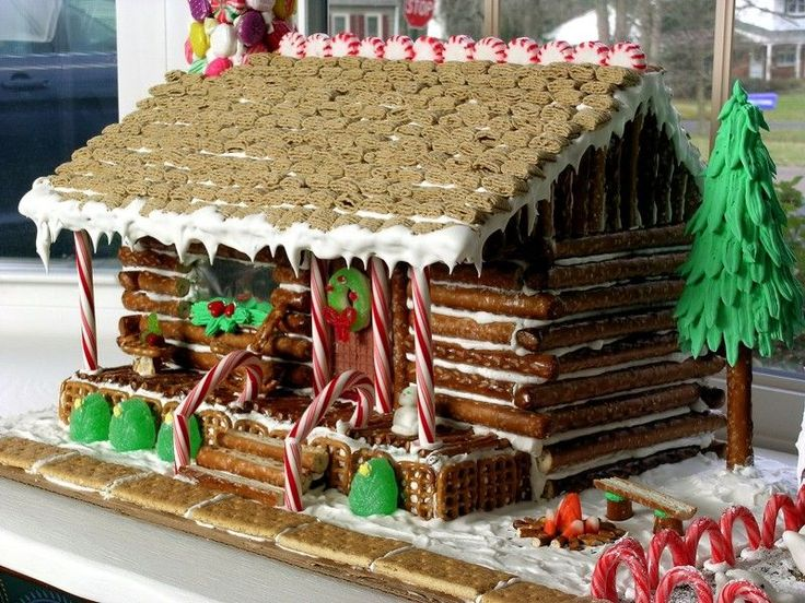 WE COULD MAKE IT A LOG CABIN!  I also like the idea for the campfire and the fence of candy canes