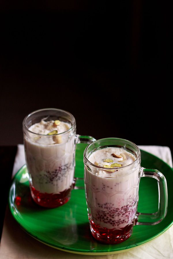 falooda recipe with ice cream - layered summer dessert beverage made with milk, rose syrup, sabja seeds, falooda sev, dry fruits and ice cream. a popular north indian summer drink. step by step recipe.
