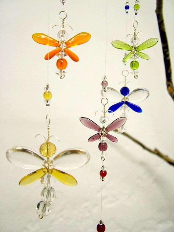 This colourful dragonfly and firefly / fairy hanging mobile has been hand crafted from Swarovski Crystal and glass beads.  This mobile has a