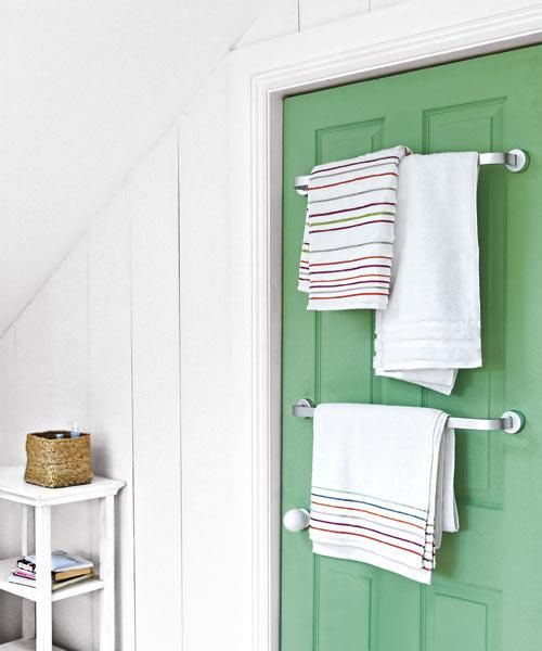 An overlooked door transforms into a focal point with Valspar's Green Godess and towel bars. | Photo: Nick Pope/IPC Images