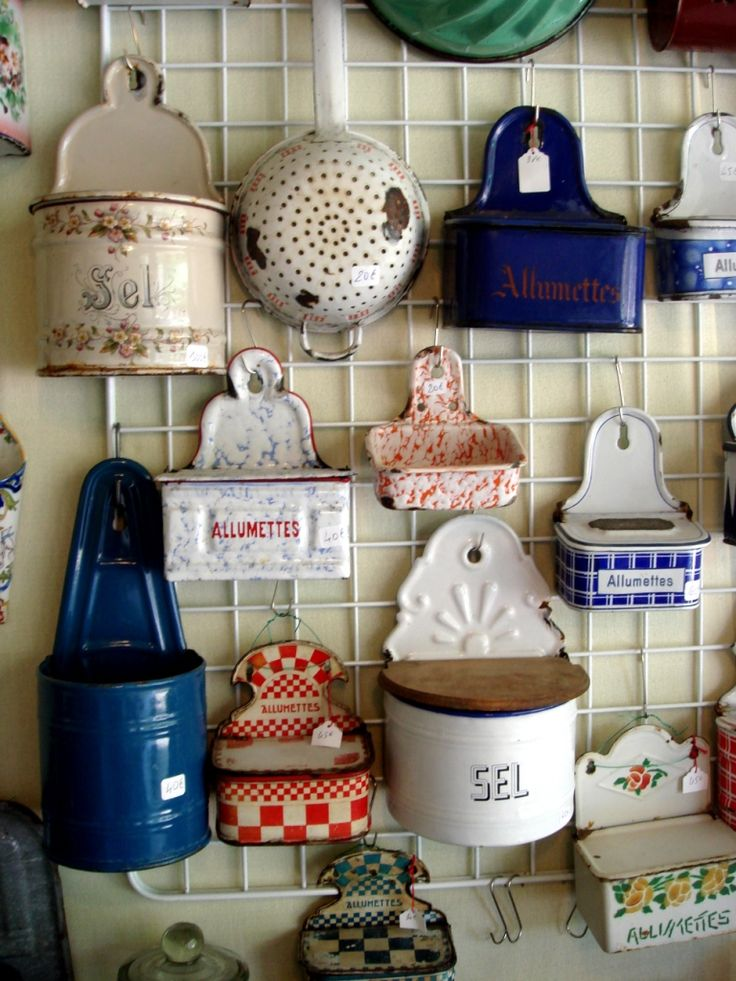 Antique kitchen accessories hanging on a retail style grid wall. This is so clever don't you think?