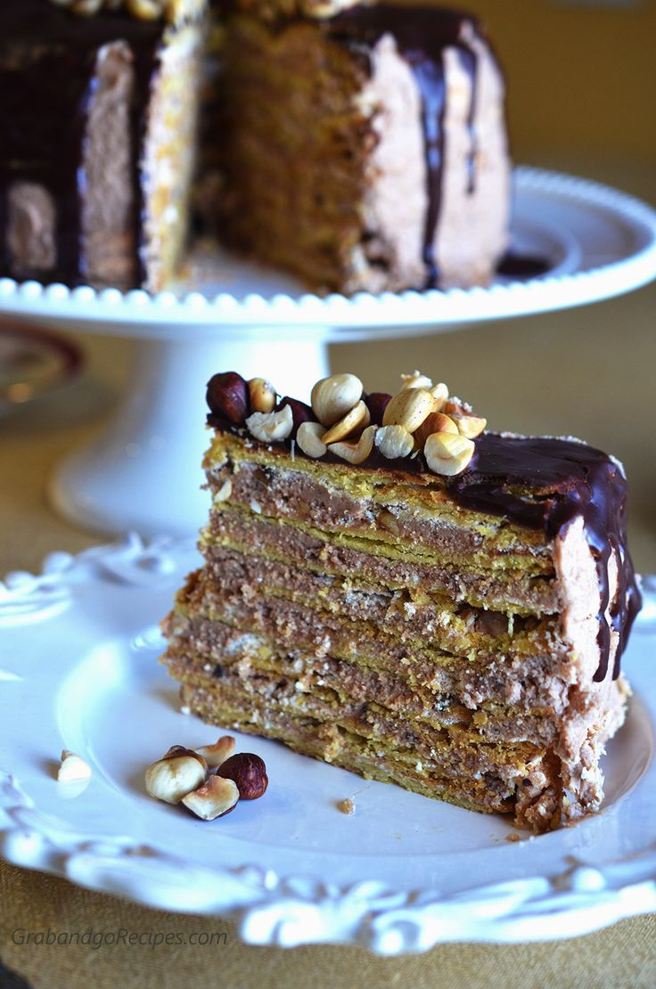 Markiza Cake (Marquise Cake) : Markiza Cake is a Multi-layered shortbread with meringue, dulche de leche buttercream, and topped with chocolate ganache and hazelnut cake. Simply delicious!