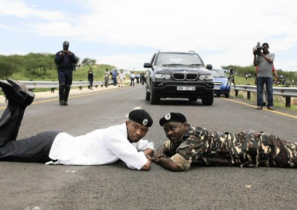 MK veterans lie in the road leading to the president's Nkandla home. | Photo: www.iol.co.za/ Sibusiso Ndlovu