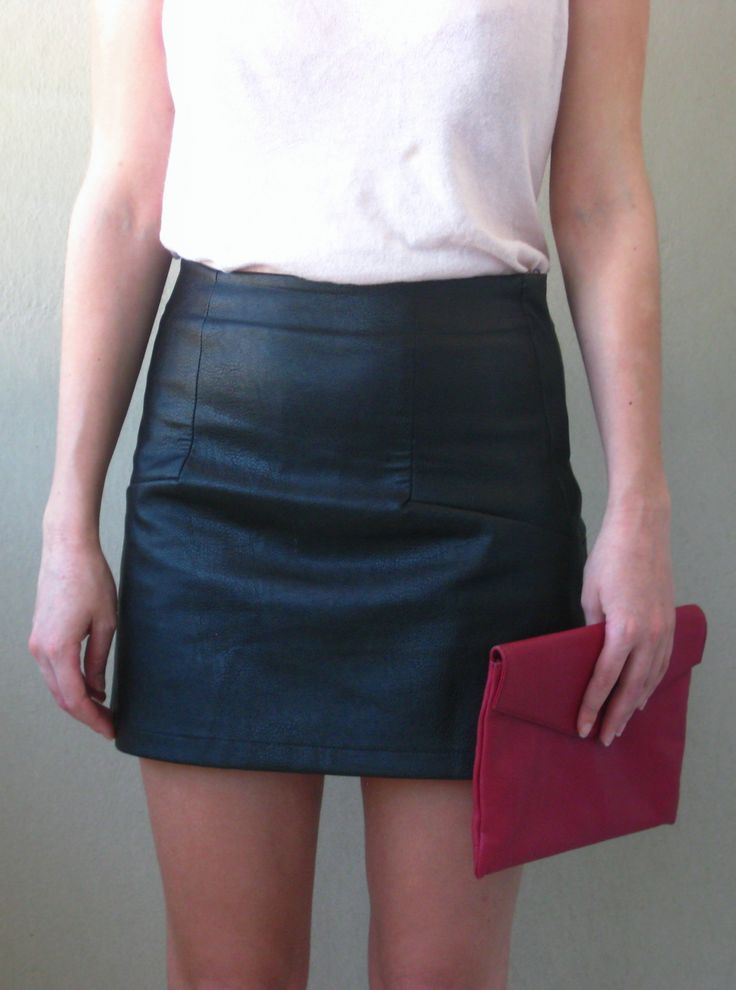 Leather mini skirt and red clutch