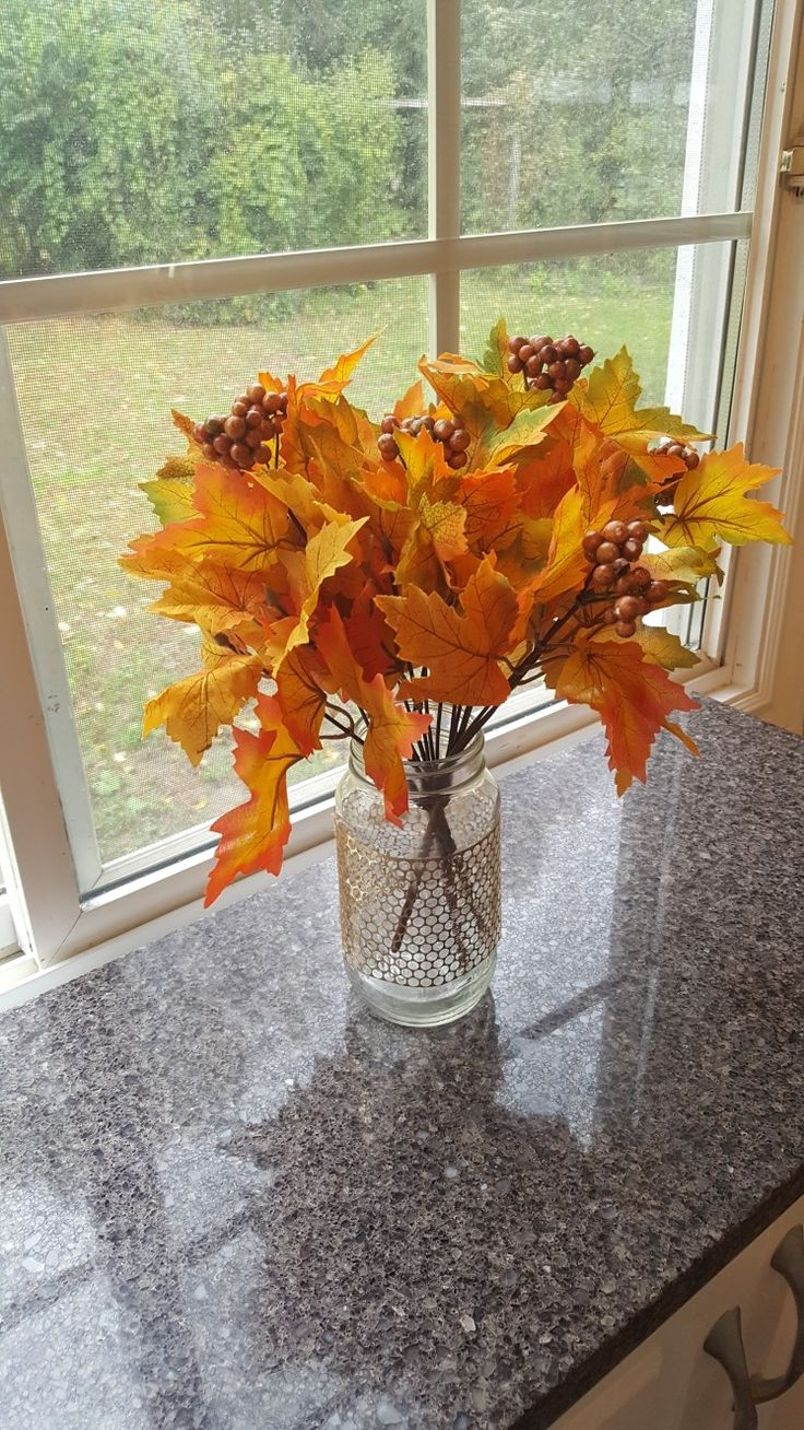 Fall/Autumn decor DIY ---Use a mason jar and get fall stems from Dollarama dollar store. Decorate mason jar with burlap. Gold decor was wrapped around this jar.