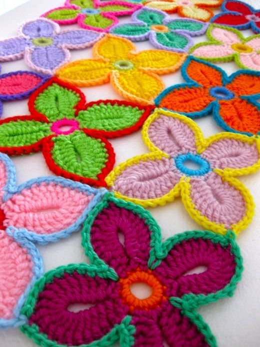 Hawaiian flowers crocheting. Very decorative, but I dont think it would make a very warm blankie...