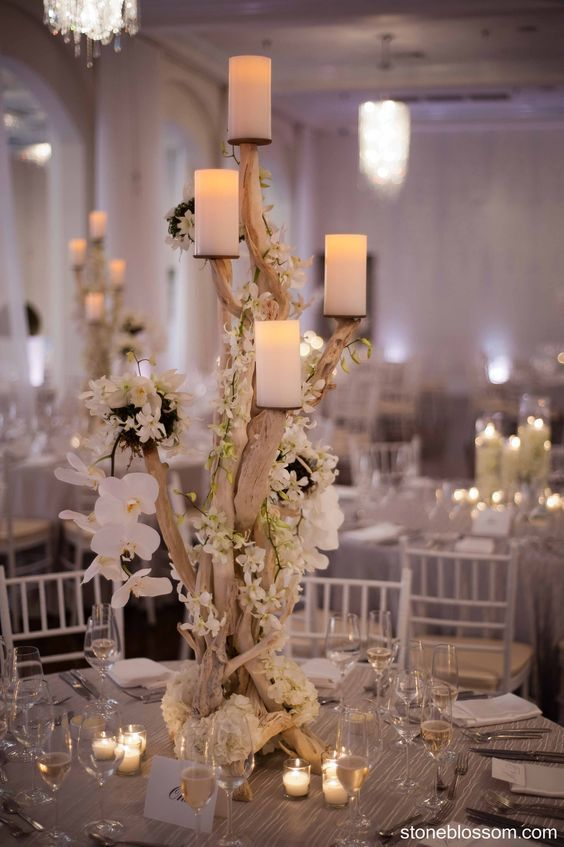 rustic white orchids candles and driftwood wedding centerpiece / http://www.deerpearlflowers.com/driftwood-wedding-decor-ideas/2/