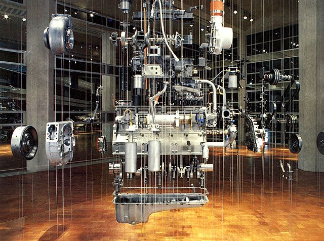 Cummings Engine installation by Rudolph De Harak    If Modernism imposes coldness and sterility, as some critics have argued, then Rudolph de Harak must be doing something wrong. A devout Modernist, his work for public and private institutions is uncompromisingly human.  Cummins Engine Company Corporate Museum, 1985. Disassembled diesel engine suspended on wires between floor and ceiling.    http://www.aiga.org/medalist-rudolphdeharak/