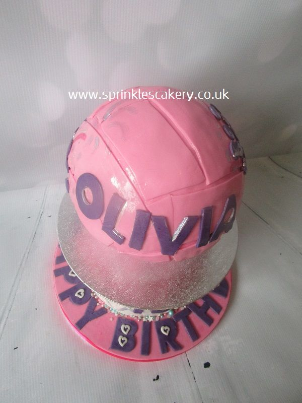 An aerial view of a pink netball cake.