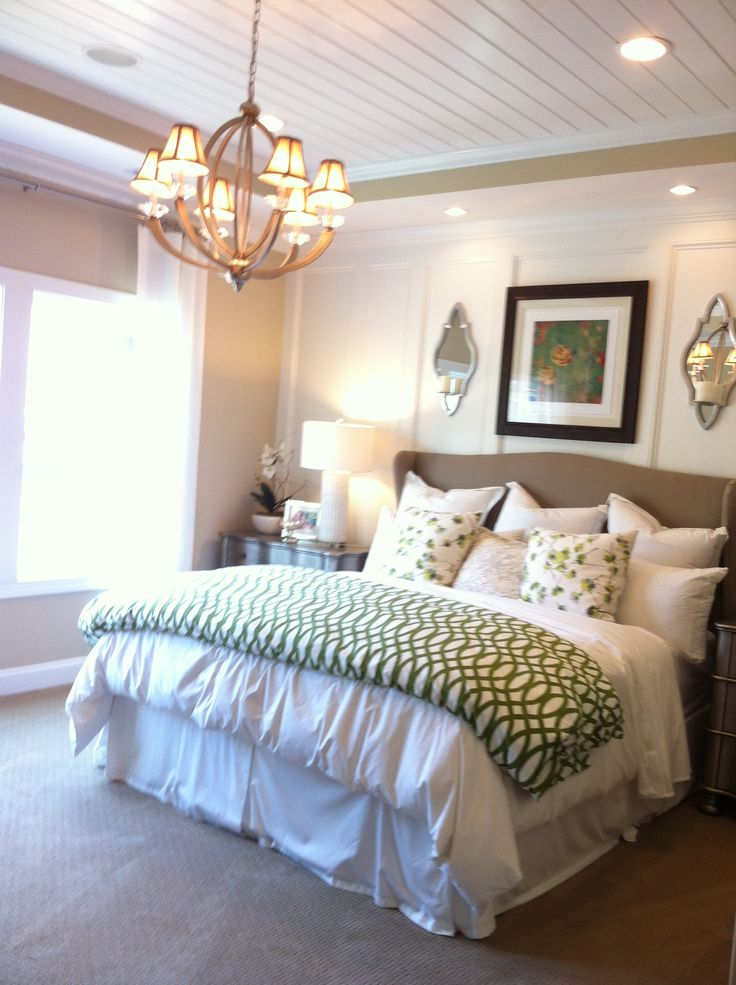 Gorgeous Master bedroom with emerald accents