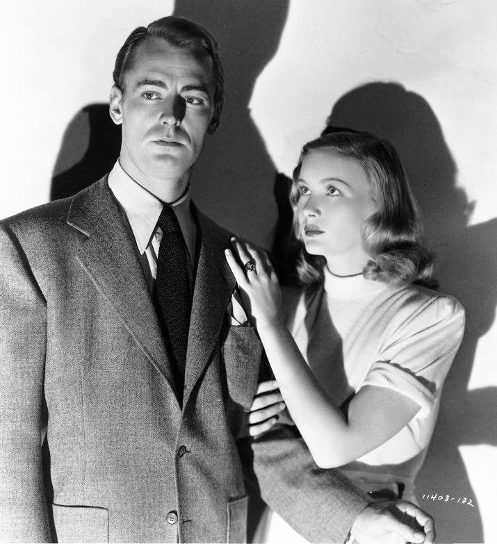 """A film noir classic, Alan Ladd, wearing a two-button suit and solid knit tie, joins Veronica Lake for The Blue Dahlia (1946). """"An ex-bomber pilot is suspected of murdering his unfaithful wife."""""""