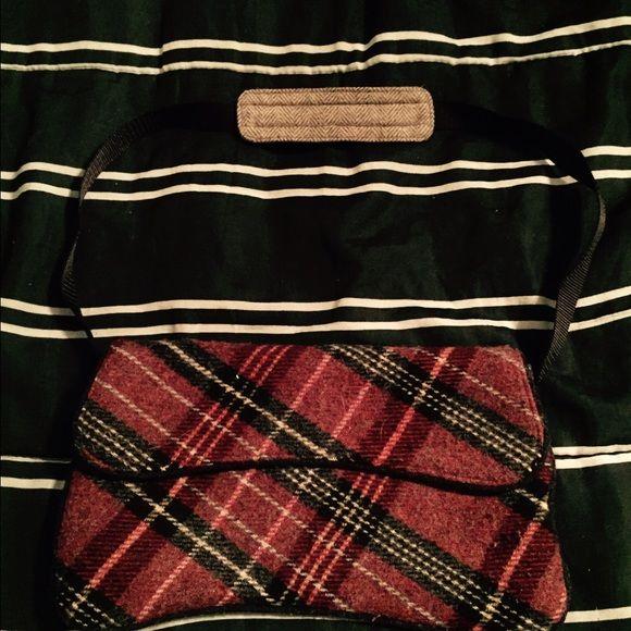 Gap handbag Cute little Gap bag. Never used. Velcro closure. Waiting for someone to love her! GAP Bags