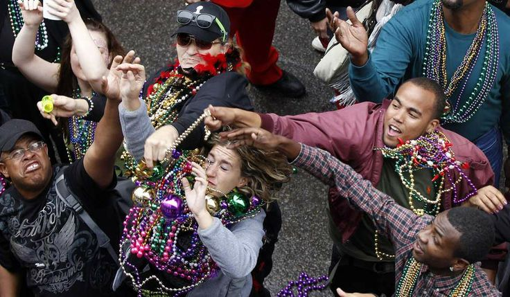 """Mardi Gra Time! """"Revelers grab for beads as they are tossed from the balcony of the Royal Sonesta Hotel on Bourbon Street during Mardi Gras in New Orleans"""""""