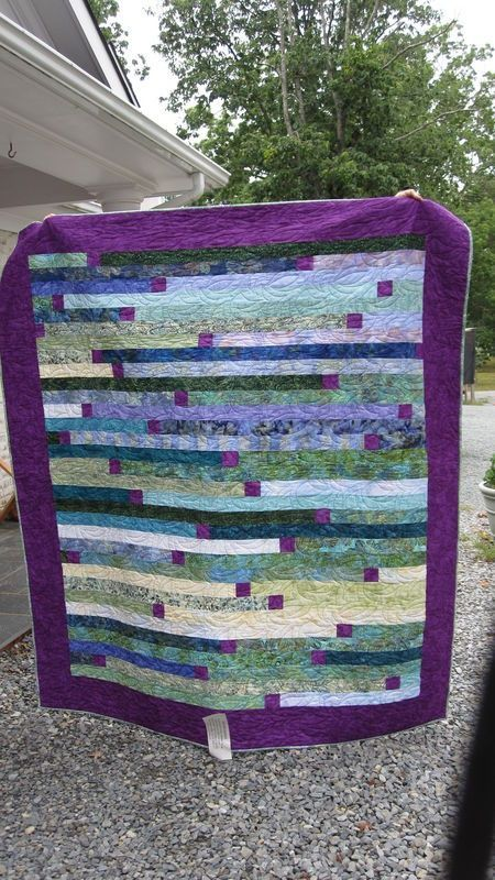 strip quilting with a square here and there.  I like the way it breaks up the 'strip' design