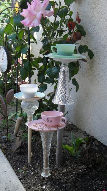 Teacup Birdfeeders from repurposed old glass vases, china tea cups; vintage cottage style; Upcycle, Recycle, Salvage, diy, thrift, flea, repurpose! For vintage ideas and goods shop at Estate ReSale & ReDesign, Bonita Springs, FL