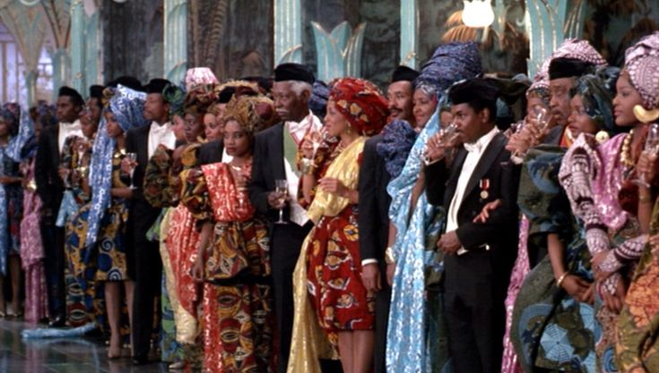 Coming to America - over the top, but beautiful African flavored gowns and head wraps in the scene where Eddie Murphy's Akeem meets his intended bride to be, played by Vanessa Bell Calloway.