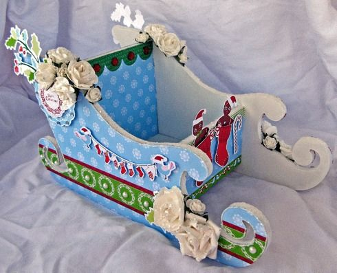 This sleigh used products from the Santa's List collection by KaiserCraft. Designed by Julianne McKenna-De Lumen.
