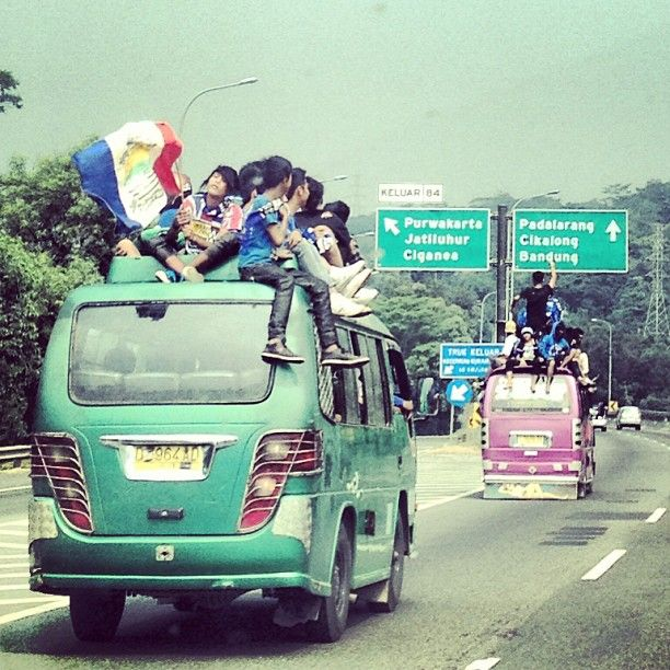 Kids, too dangerous. Their love to football club is too big. (Persib Bandung fans club, Jakara-Bandung Highway)