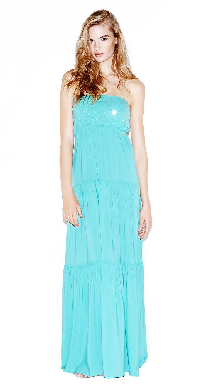 Model wears NaughtyDog blue bandeau long dress decorated with Swarovski crystals.