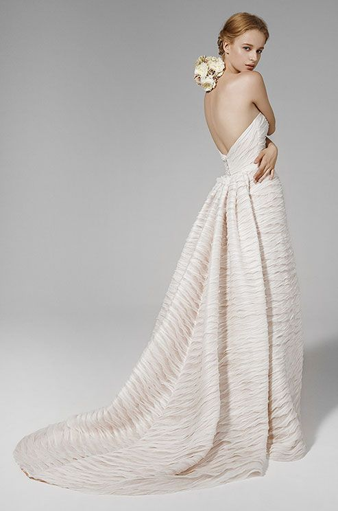 Strapless mermaid gown with linen folded bands with nude under lyer. Peter Langner, 2016