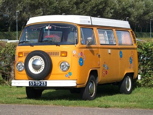 orange flower power vw type camper