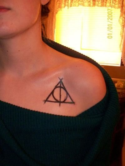 I LOVE HARRY POTTER. And the deathly hallows symbol is just so cool. I like the imperfection of this one, and I don't know exactly where I would put it, but I would probably get it in white, so later, it'll look like a scar.