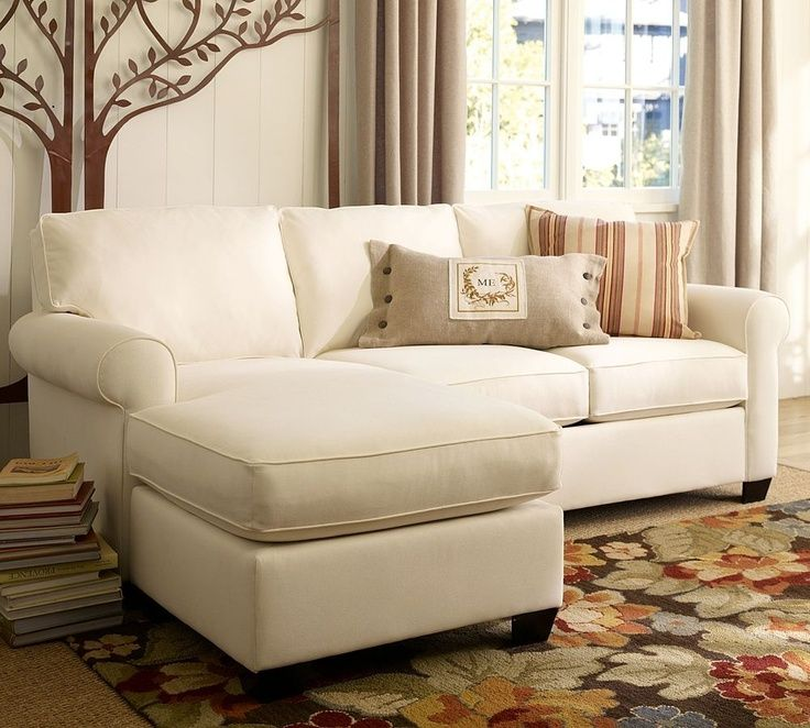 white sectional sofa with chaise lounge chair and 2 cushions