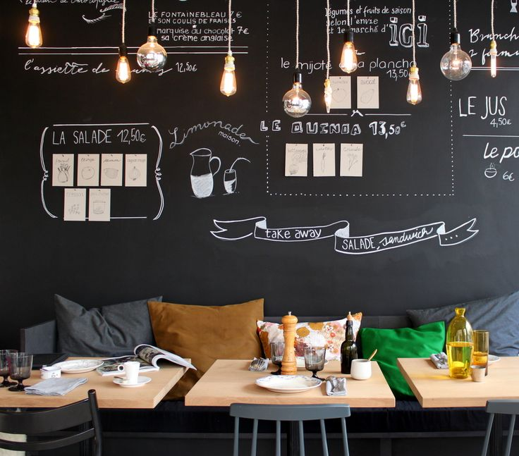 Cute eclectic decor @ Ici cafe. Love the mis-matched bare bulbs, comfy communal bench seating & practical chalkboard wall.