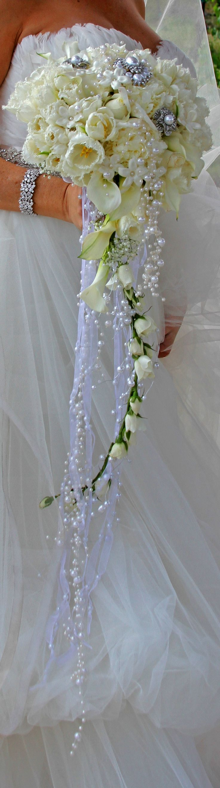 Brides 20's inspired cascade bouquet with broaches and falling pearls and sheer ribbon Floral design by Suzanne M Smith www.suzannemsmithdesigns.com