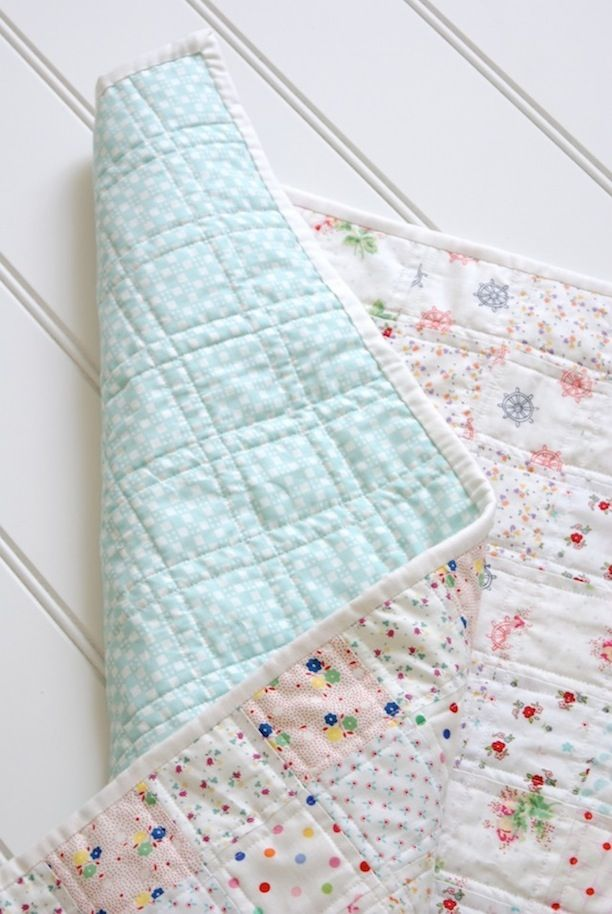Strip pieced quilt with double straight line quilting.  Love everything about this simple quilt!