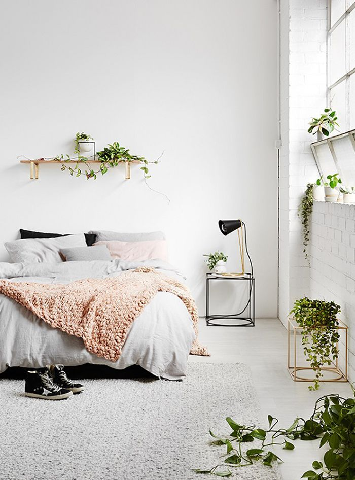 rugs in the home   bedroom   house plants   minimal interior design   clean space idea http://thelovelydrawer.com/make-your-rented-house-a-home/
