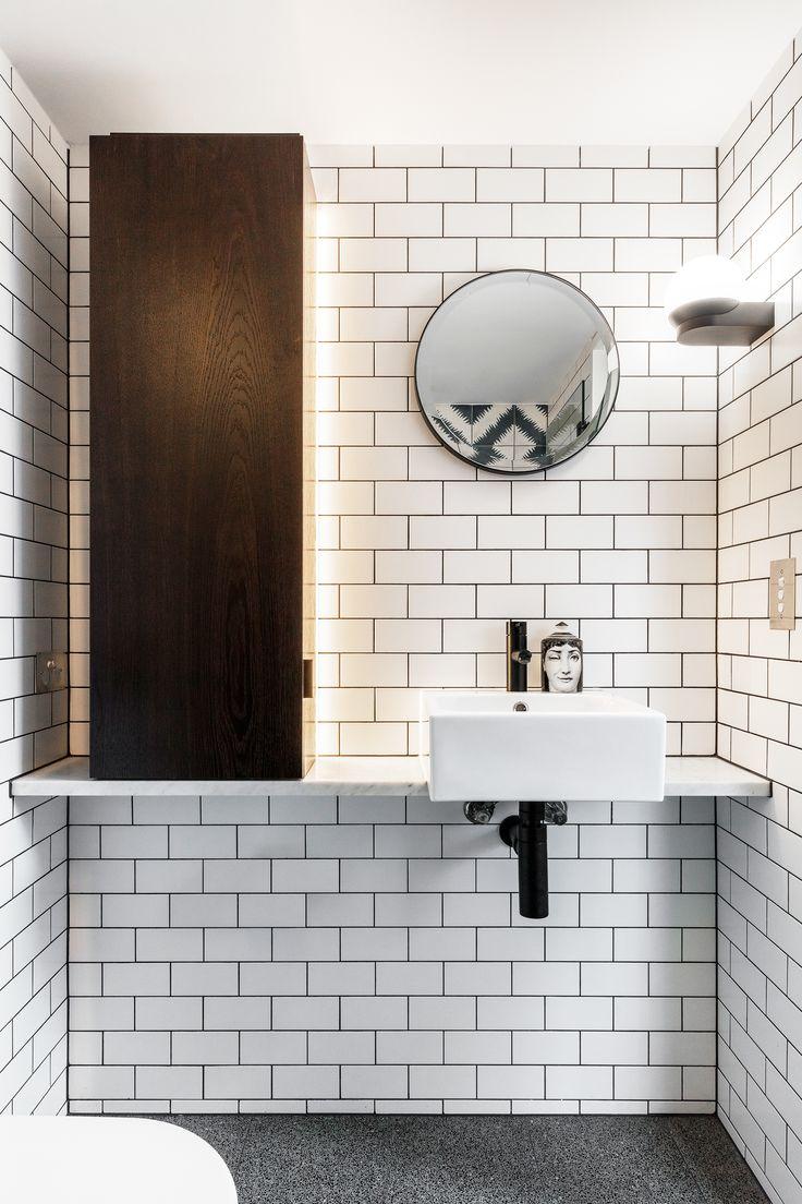 Black and white bathroom from Sydney terrace house renovation by TFAD. Photography: Tom Ferguson