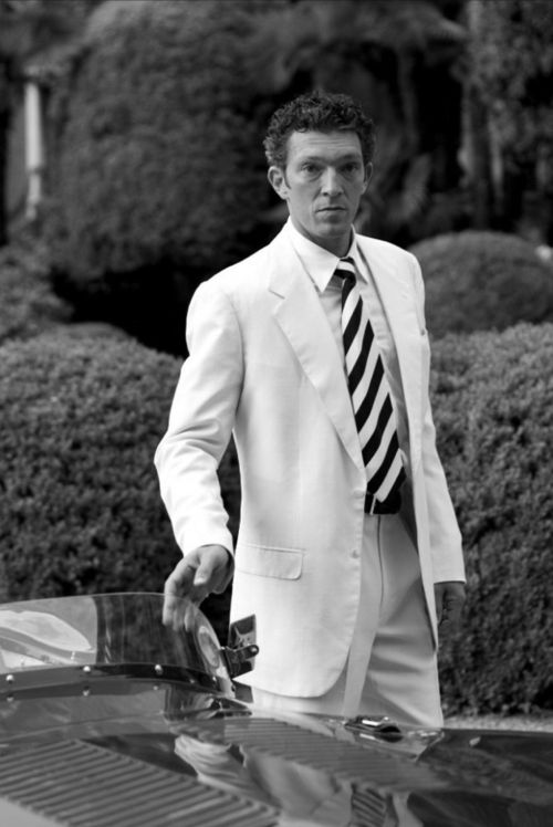 Immaculate white, with a college striped tie. Powerful.