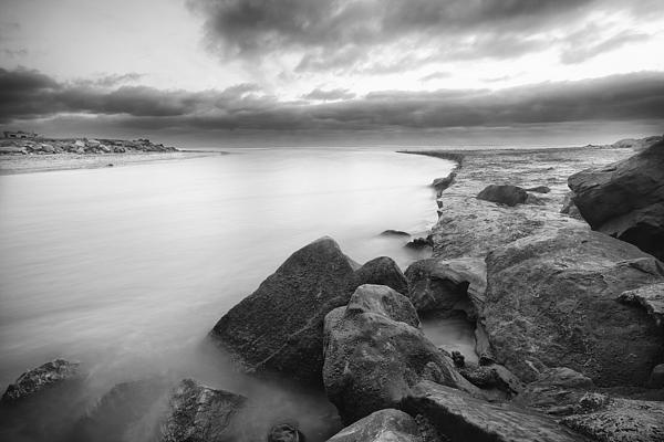 This is a long exposure of the lagoon outflow to the ocean in Cardiff California. Notice how the long exposure smoothes out the moving water.