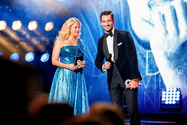 German presenter Barbara Schoeneberger and model, influencer and award winner David Gandy live on stage at the GQ Men of the year Award 2017 show at Komische Oper on November 9, 2017 in Berlin, Germany.