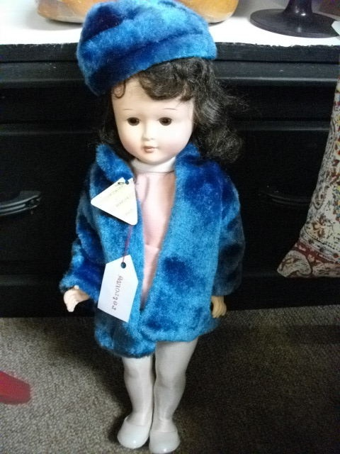 Vintage plastic doll with original clothes and labels, blue outfit. Vintage doll.
