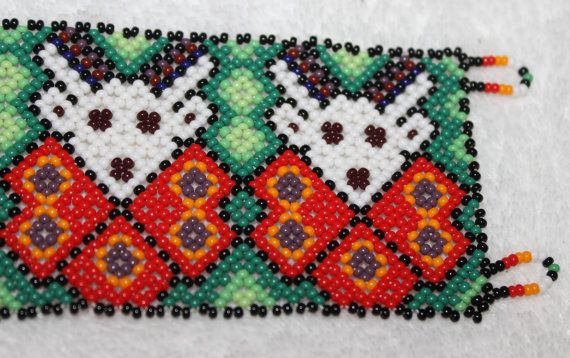 FREE Shipping to United States  Anywhere else in the World With the purchase of two or more Bracelets Contact Me for free shipping   Length: 7.5 inches  Width: 2 inches  Huichol are an indigenous, Indian, ethnic group of western central Mexico, living in the Sierra Madre Occidental range in the Mexican states of Nayarit, Jalisco, Zacatecas, and Durango. The beaded art is a relatively new innovation and is constructed using glass, plastic or metal beads. Common bead art forms include masks…