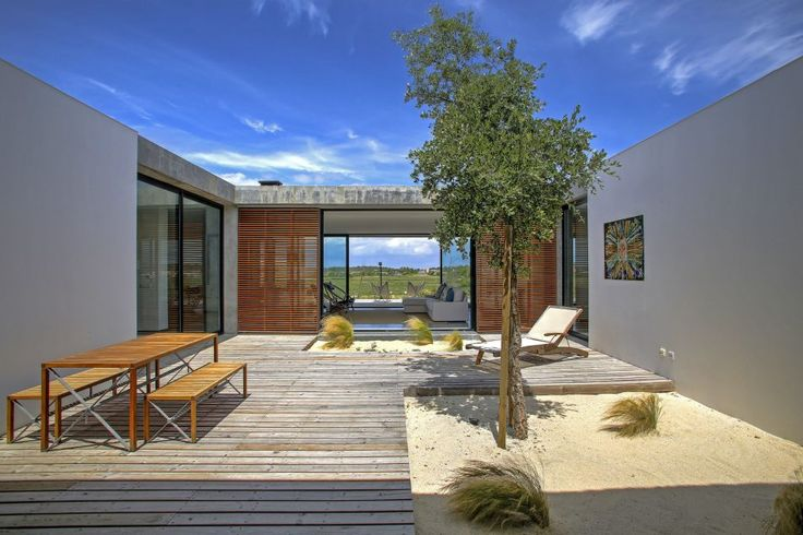 This stunning modern house is located metres from Pego Beach, on theAlentejo coastline. Property The single-storey luxury villa, which rises from the sand dunes, has a private heated pool, sunny terrace, landscaped gardens and breathtaking views. It is located in Comporta,one ofPortugal'smostexclusivecoastal areas; Pego Beach has been named Portugal'sbest beach for itsclear waters and clean […]