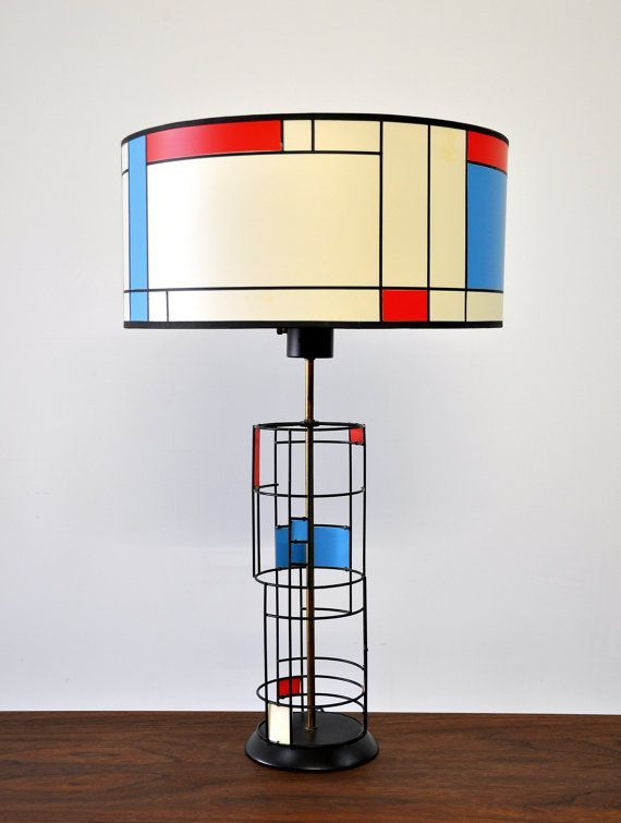 Amazing Mid Century Modern table lamp dating from 1953. Features brass rod and iron frame with beautifully painted accents in red, blue and